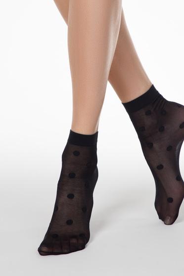 Fekete zokni pöttyös